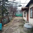 Продам дом с гаражом в центре Черноморки с большим участком
